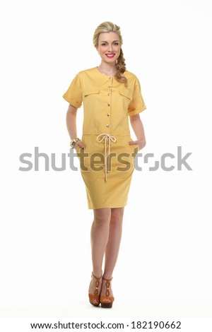 Beautiful Busyness Woman Blonde Fashion Mode in yellow dress isolated on white - stock photo