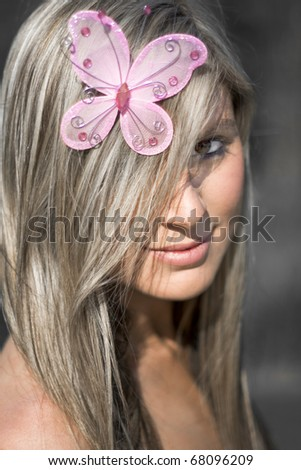 Beautiful Butterfly Babe Wearing A Fly Hair Tie Trinket On Her Head In The Shape Of A Pink Butterfly - stock photo