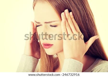 Beautiful cacuasian woman having headache. - stock photo