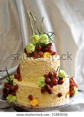Beautiful cake decorated with fresh flowers and fruit - stock photo