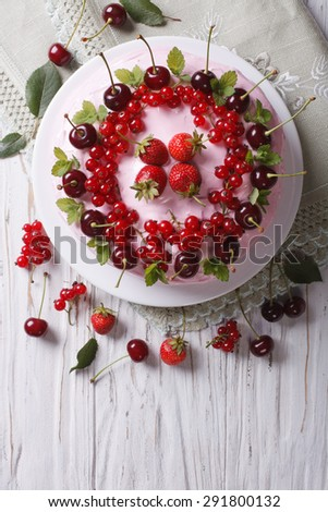 beautiful cake with fresh berries on a plate close-up. vertical top view - stock photo