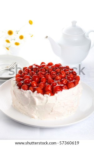 beautiful cake with strawberries and cream on white isolated background - stock photo