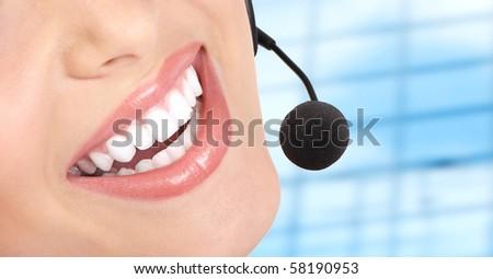 Beautiful  call center operator with headset. Isolated over white background - stock photo