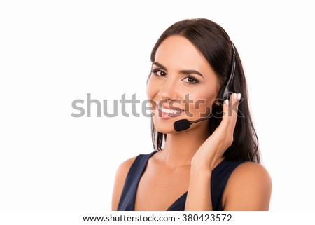 Beautiful call center operator with microphone and headphone smiling - stock photo