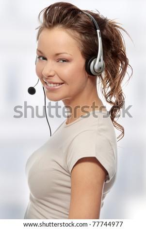Beautiful Call Center Woman Wearing A Telephone Headset - stock photo
