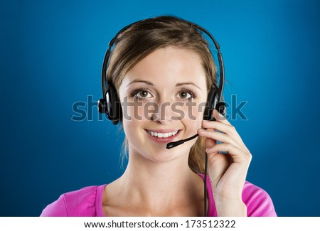 Beautiful call center young woman is ready for business support - stock photo