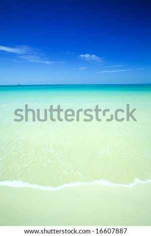 Beautiful calm beach with crystal blue waters of the Andaman sea, Krabi,Thailand. - stock photo