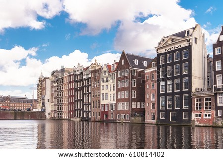 Beautiful canals with old dutch historical houses alongside the canals, Amsterdam March 2017 netherlands