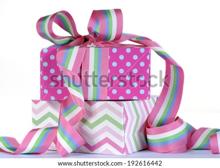 Beautiful candy color gifts with bright pink and blue polka dots with pink, blue, green and white stripe ribbon for birthday, baby, bridal shower, wedding,  Christmas, Fathers Day or Mothers Day. - stock photo