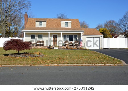 Beautiful Cape Cod style home autumn day clear blue sky  Japanese Elm Tree residential neighborhood USA - stock photo