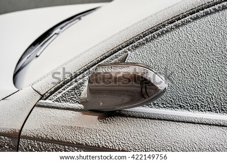 Beautiful car covered with snow - Topaz Brown Metallic color - stock photo