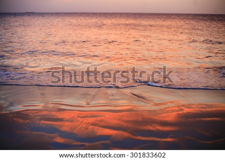 Beautiful Caribbean beach, waves on the beautiful romantic sandy beach in Dominican republic, Sandy beach with reflection of the sun, heaven on earth, most beautiful beach on the world - stock photo