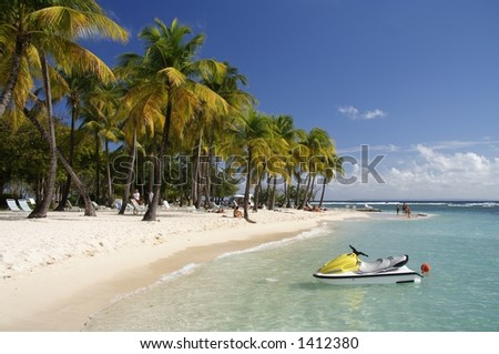 Beautiful caribbean lagoon with jetski - stock photo
