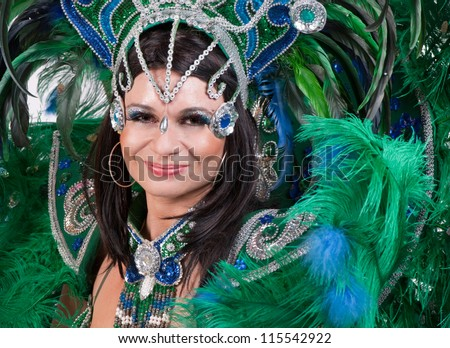 Beautiful carnival dancer in amazing costume - stock photo