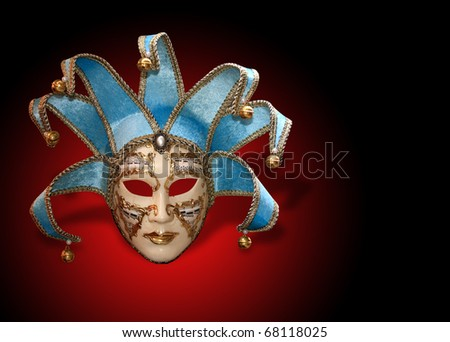 Beautiful carnival mask from venice Italy over dark red background - stock photo