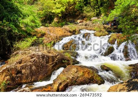 Beautiful cascade of the Datanla waterfall in Da Lat city (Dalat), Vietnam. Da Lat and the surrounding area is a popular tourist destination of Asia. - stock photo