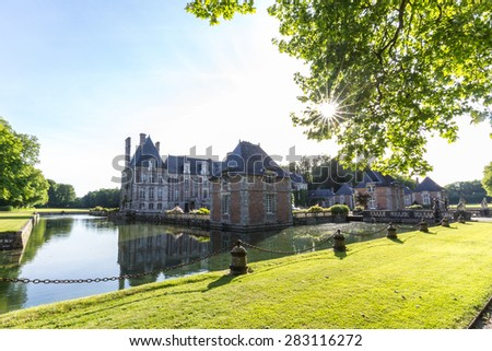 Beautiful castle souht of Paris, France, in the style of Louis-XIII, with moat all around it.