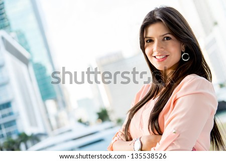 Beautiful casual woman looking very happy in Miami - stock photo