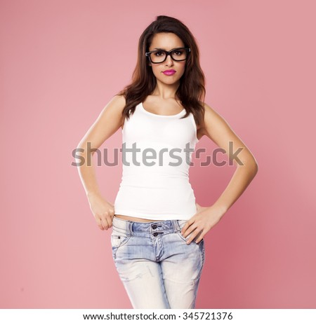 Beautiful casual woman over a pink background.