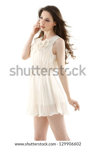 Beautiful casual young woman standing isolated against - stock photo