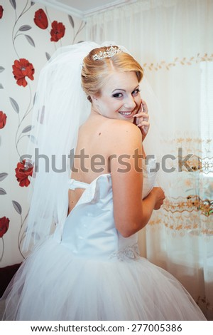 Beautiful caucasian bride getting ready for the wedding ceremony. - stock photo