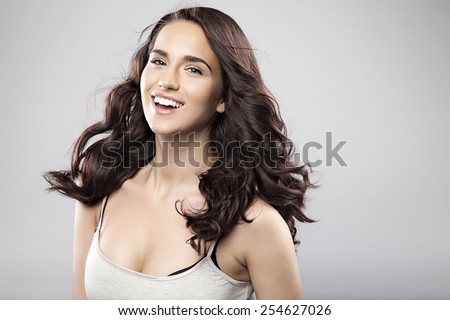 Beautiful caucasian brunette woman with long shiny brown hair and clean skin. Portrait of a fashion model in studio - stock photo