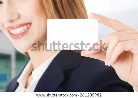 Beautiful caucasian business woman holding small personal card. - stock photo