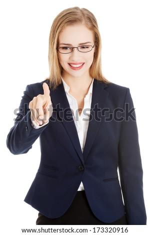 Beautiful caucasian business woman is pushing button on empty space. Isolated on white. - stock photo