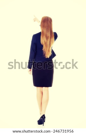 Beautiful caucasian business woman pointing up. - stock photo