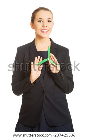 Beautiful caucasian business woman with green propeller. Isolated on white. - stock photo