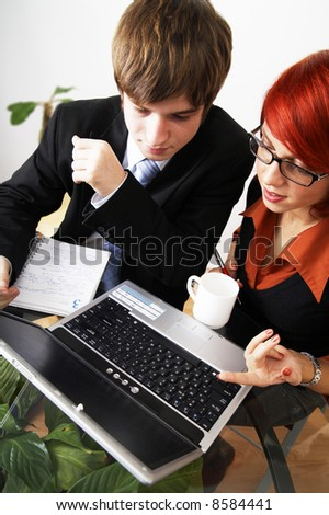 beautiful caucasian business woman with young consultant - stock photo