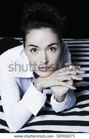 beautiful caucasian  charming woman portrait in a hotel bedroom - stock photo