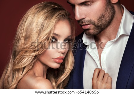 Beautiful caucasian couple in love. Elegant look. Studio shot.