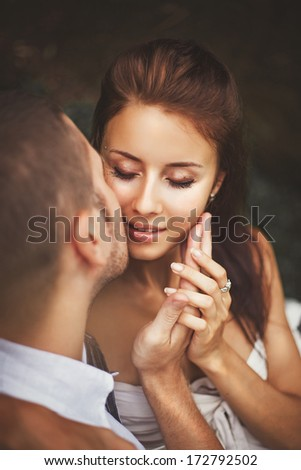 Beautiful caucasian couple kissing - stock photo