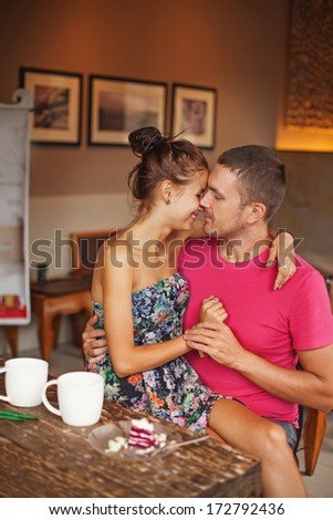 Beautiful caucasian couple kissing at home - stock photo