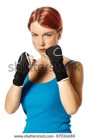 beautiful caucasian female boxer wearing boxing gloves - stock photo