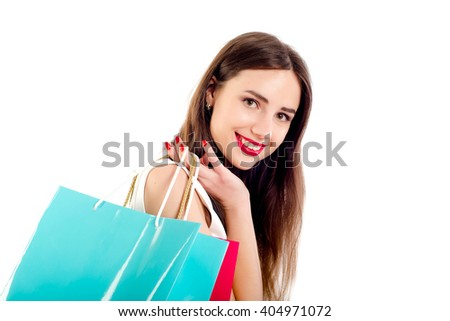 beautiful caucasian female in dress with shopping bags. Studio shot on white background