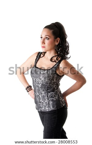 Beautiful caucasian female with ponytail wearing gray tank top and jeans and hands on hips, isolated - stock photo