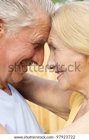 Beautiful Caucasian fortune couple of elderly people in nature