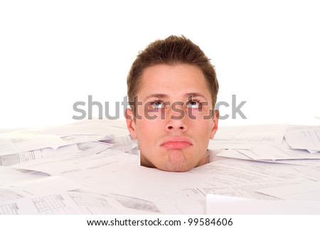 Beautiful Caucasian male's head buried in the paper on a light background - stock photo