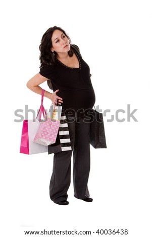 Beautiful Caucasian pregnant brunette woman holding shopping bags while standing and having back pain, isolated - stock photo