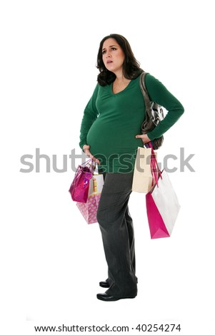 Beautiful Caucasian pregnant brunette woman holding shopping bags while standing expressing pain and holding belly as if her water broke, isolated - stock photo