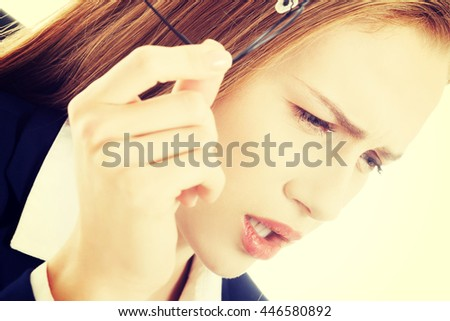 Beautiful caucasian surprised business woman - stock photo
