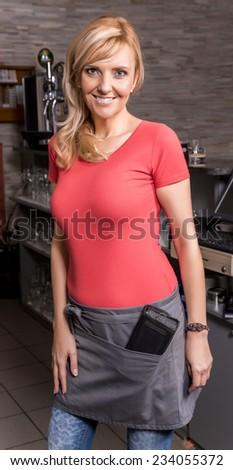 Beautiful caucasian waitress smiling in the coffee shop. - stock photo