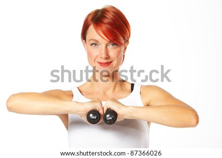 Beautiful caucasian woman curls dumbbells over white background - stock photo