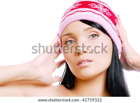 Beautiful caucasian woman in red winter hat
