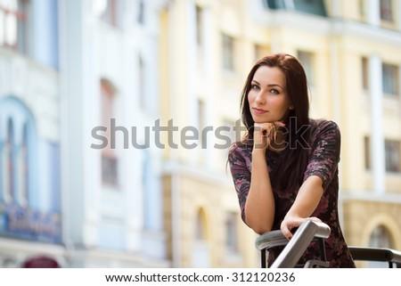 Beautiful caucasian woman in the city - stock photo