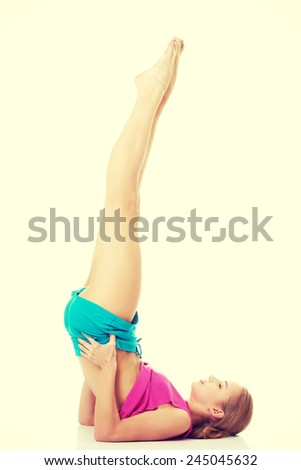 Beautiful caucasian woman is doing exercises.  - stock photo
