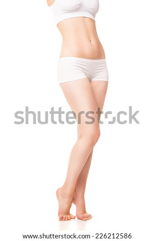 Beautiful caucasian woman's body with long legs, isolated on white background - stock photo