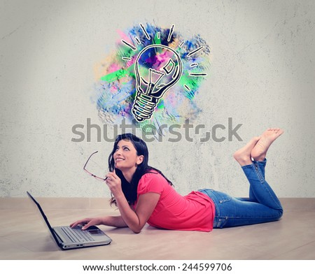 Beautiful Caucasian woman smiles thinking in front of his laptop. Concept of the Internet. Woman lying full length isolated on white background - stock photo